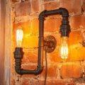 Som et vandrør – væglampen Tap